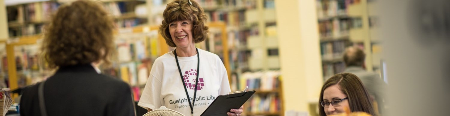 Guelph Public Library Staff helping patron